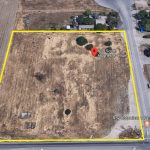 Aerial Map of 618 S. Hughes Ave., Fresno. Vacant land with more vacant land on right and industrial buildings on right.