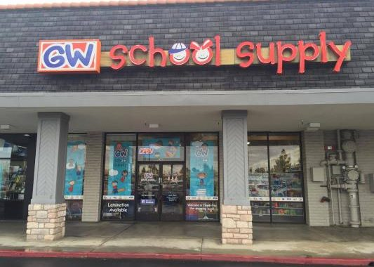 Exterior photo of GW School Supply store front on Blackstone Avenue. Large signage reads GW School Supply.