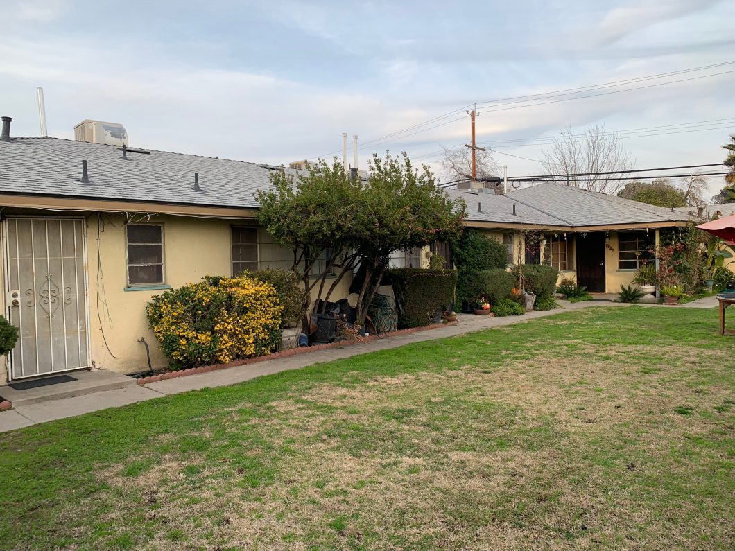 2914-2920 N. First St., Fresno. Exterior photo of fourplex with grass yard.