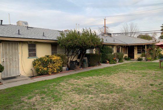 2914-2920 N. First St., Fresno. Exterior photo of fourplex with grass yard.