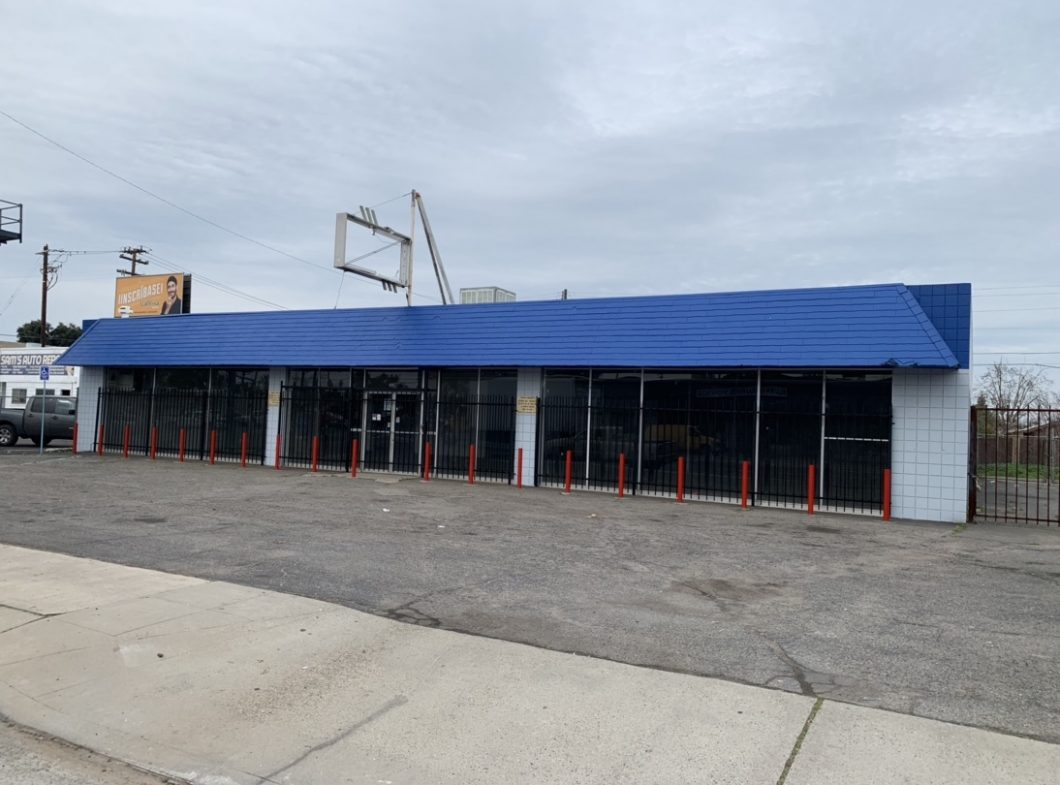 4235 E. Belmont Ave., Fresno. Exterior photos of commercial building and parking lot. Building painted blue and white. Signage mounted on the roof.