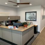 2740 N. Sunnyside Ave., Fresno. Office/warehouse for lease. Front reception area. Large gray reception desk.