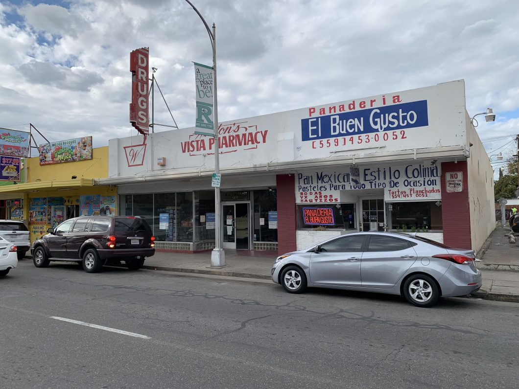 4233-4235 E. Tulare St., Fresno. Multi-tenant retail building for sale. One unit's signage reads Winton's Vista pharmacy with blade signage that reads drugs. Other unit's signage reads Panaderia El Buen Gusto. Brick building with large front windows. Photo take from Tulare St.