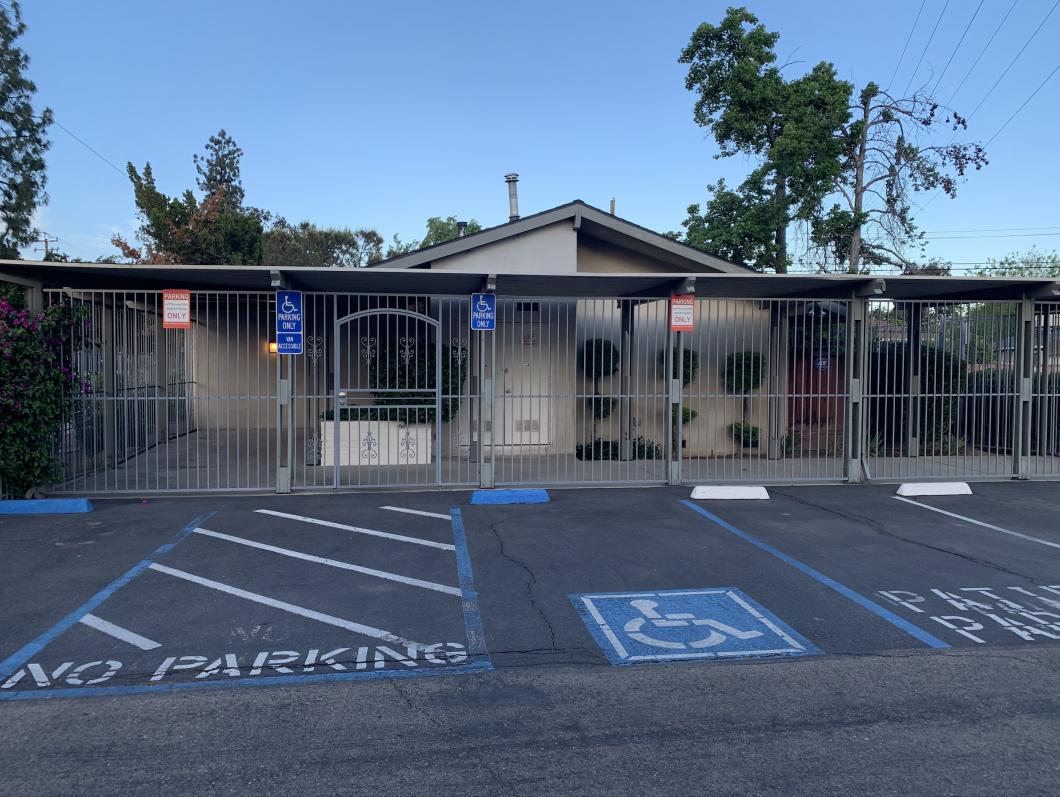 3738 E. Shields Ave., Fresno. Dental practice building and business for sale. Exterior photo from parking lot. Accessible parking, security gate in front of building.