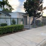 3738 E. Shields Ave., Fresno. Exterior photo from street. Sidewalk, metal security gate, and building.