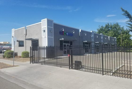 901 N. Blackstone Ave., Fresno. Exterior of multi-tenant commercial building with security gated parking lot facing Blackstone Avenue.