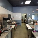 Sandwich and coffee shop business for sale. Interior photo of equipment behind front counter.
