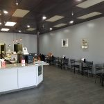 Sandwich and Coffee shop for business. Interior photo of front counter and seating.