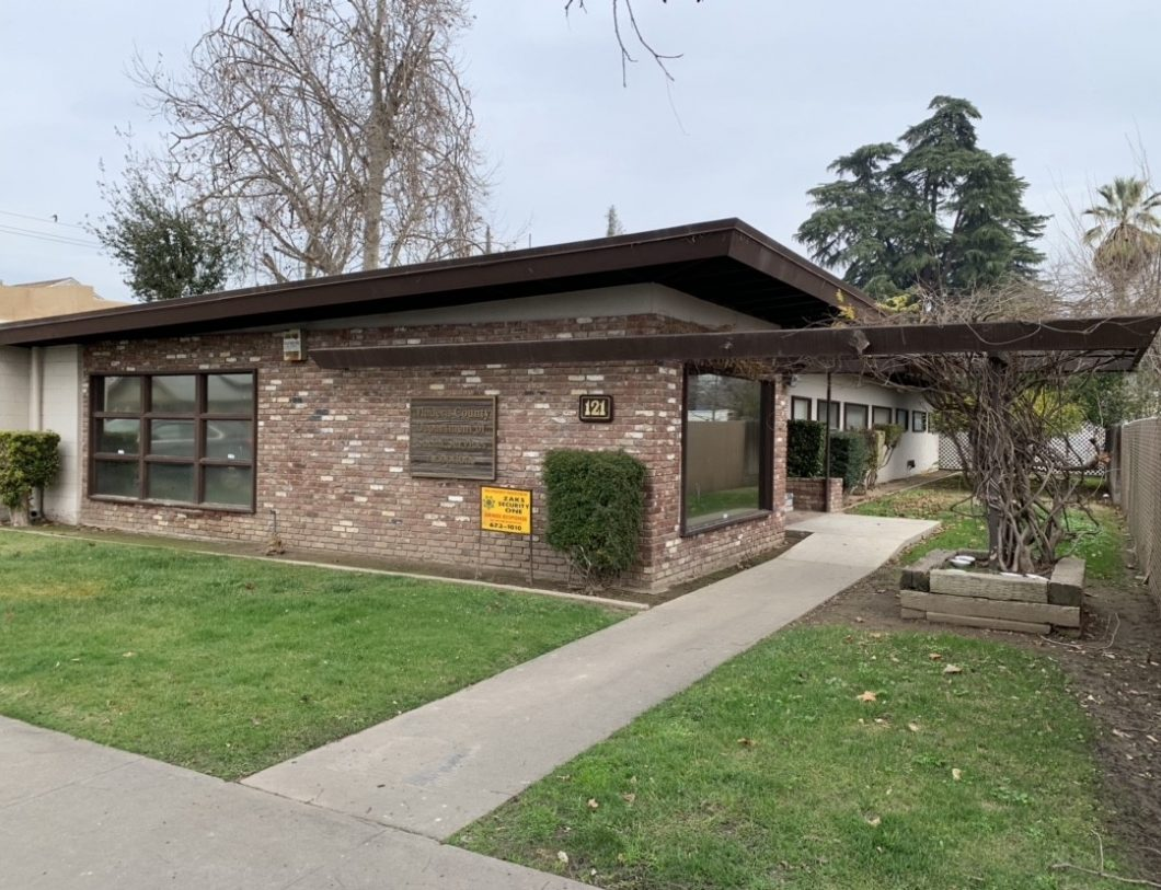121 N. Lake St., Madera. Office Building for sale. Exterior building facing front entrance. Mid-century modern architecture. Brick exterior, slanted rood, and brown trim.