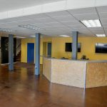 2210 San Joaquin St., Fresno. Interior. Lobby area. Large front reception desk. Pillars.