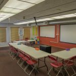 2210 San Joaquin St., Fresno. Interior. Upstairs classroom. Whiteboard. Tables and chairs.