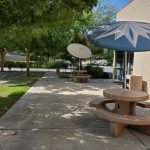 1244 N. Mariposa St., Fresno. Exterior photo. Outdoor patio area. Cement tables and benches with hard sun shades.