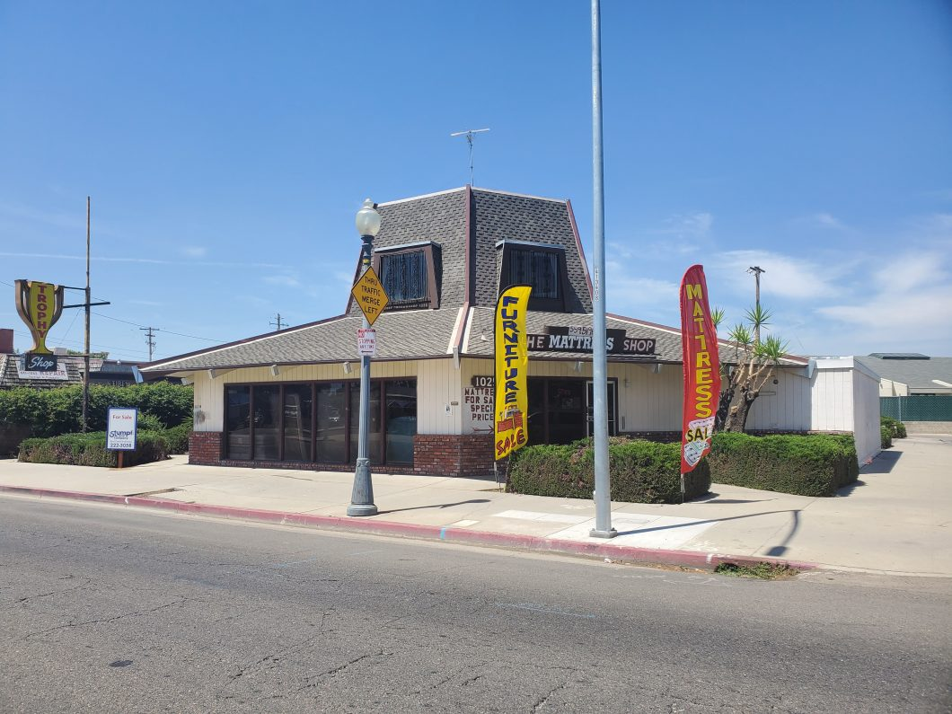 Exterior photos of freestanding retail building located at 1025 N. Blackstone Ave., Fresno. Building is hexagon-shaped. Ground floor with small loft space and windos on top. Facing street.
