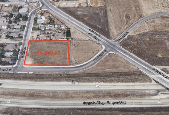 Aerial photo of vacant lot for sale. 458-090-83. Leveled dirt lot on the corner of Hughes and Dan Roquillo. Just north of Freeway 180. Surrounded by other vacant lots and homes with large lot.